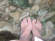 My hot feet in that clear icy rock pool!