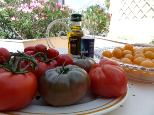 Still life with tomatoes, prunes, olive oil and salt
