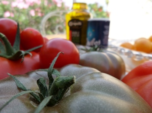 Still life with black tomatoes